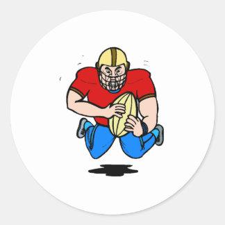 Futbolista del dibujo animado pegatina redonda