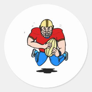 Futbolista del dibujo animado etiqueta redonda