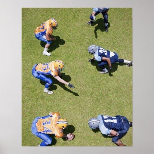 Futbolistas que juegan a fútbol impresiones