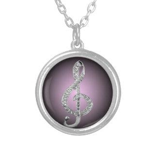 G-clef de los símbolos de música colgante redondo