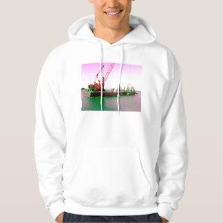 Gabarra flotante con la grúa verde y púrpura sudaderas con capucha