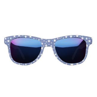 Gafas de sol estrelladas del azul de la noche