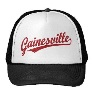 Gainesville script logo in red distressed trucker hat