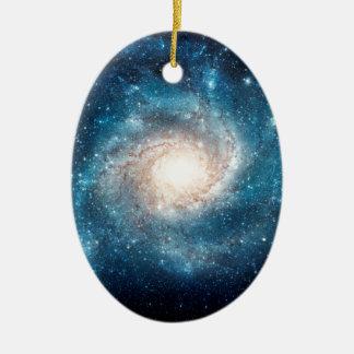 Galaxia espiral adorno navideño ovalado de cerámica