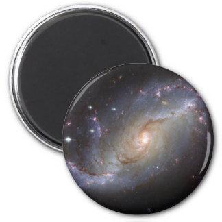 Galaxia espiral NGC 1672 por el telescopio de Hubb Imanes