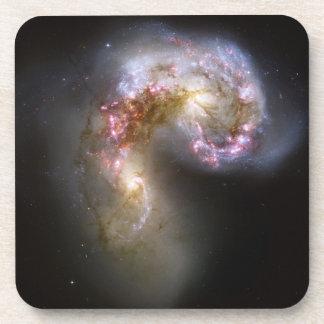 Galaxias de las antenas posavasos de bebidas