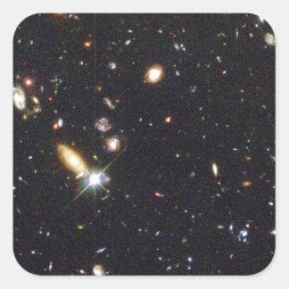 Galaxias innumerables de nuevo al principio del pegatina cuadrada