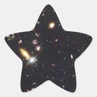 Galaxias innumerables de nuevo al principio del pegatina en forma de estrella