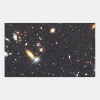 Galaxias innumerables de nuevo al principio del pegatina rectangular