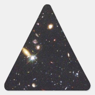 Galaxias innumerables de nuevo al principio del pegatina triangular