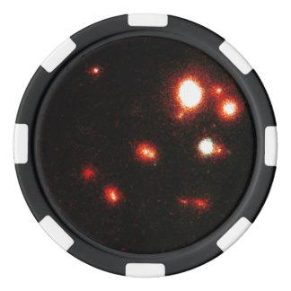 Galaxias que obran recíprocamente en un racimo fichas de póquer