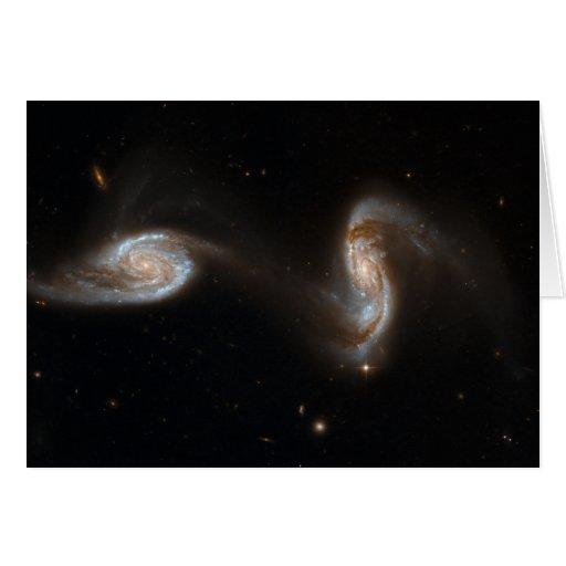 Galaxias que obran recíprocamente tarjeton