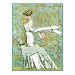 Galgo y señora de Nouveau del arte con la flor