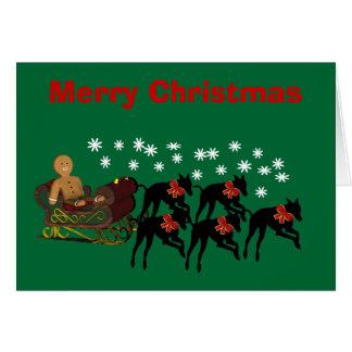 Galgos del navidad que tiran de la tarjeta del día