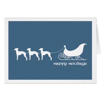 Galgos italianos que tiran del trineo de Santa Felicitaciones