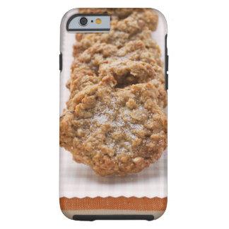 Galletas de la avena en la placa funda de iPhone 6 tough
