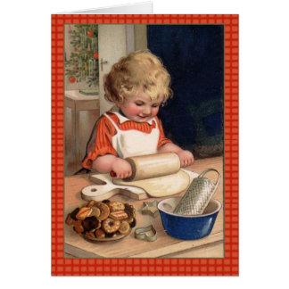 Galletas del navidad de la hornada del chica del e tarjetón