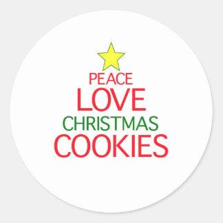 Galletas del navidad del amor de la paz etiquetas redondas