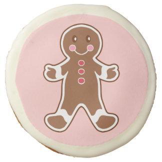 Galletas rosadas del muchacho del pan de jengibre