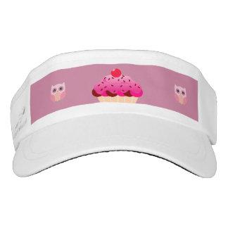 galletas y gorra rosados y blancos de los búhos visera