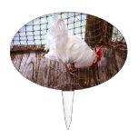 gallo blanco en la consumición del muelle figura de tarta