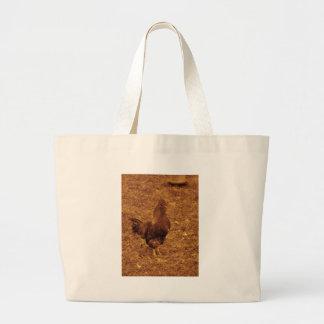 Gallo del tono de la sepia que hace frente a la de bolsa