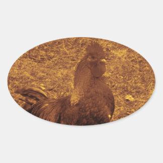 Gallo del tono de la sepia que hace frente a la pegatina ovalada