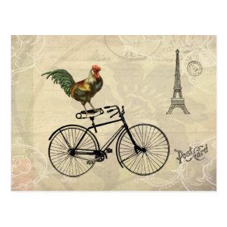Gallo del vintage que monta una bici por la torre tarjetas postales