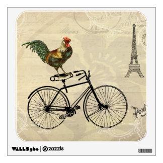 Gallo del vintage que monta una bici por la torre  vinilo decorativo