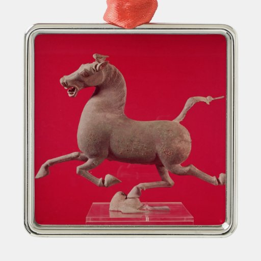 Galloping horse with one Hoof Resting on a Christmas Tree Ornament