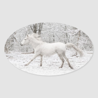Galloping White Horse in the Snow Oval Sticker