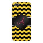 Galones negros y amarillos del monograma iPhone 5 coberturas