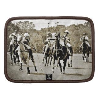 Galope de los caballos del polo organizadores