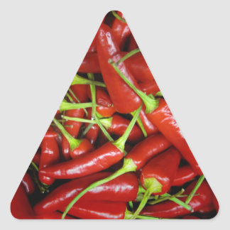 Gama del regalo de las pimientas de chiles rojos calcomanía triangulo