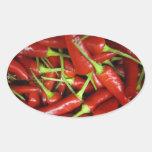 Gama del regalo de las pimientas de chiles rojos calcomanías de ovales