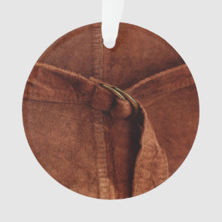 Gamuza marrón con la correa y la hebilla