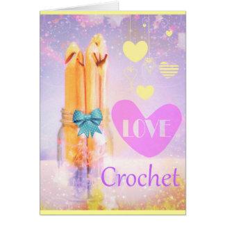 Ganchos de ganchillo del amor en diseño de la foto felicitaciones