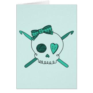 Ganchos del cráneo y de ganchillo fondo de la tur tarjeta