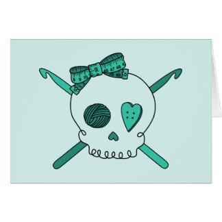 Ganchos del cráneo y de ganchillo fondo de la tur tarjeton