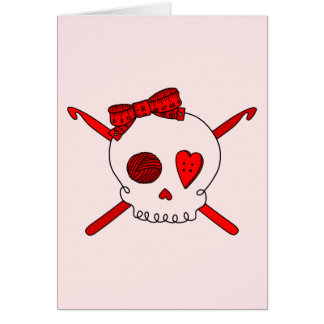 Ganchos del cráneo y de ganchillo fondo rojo tarjetón
