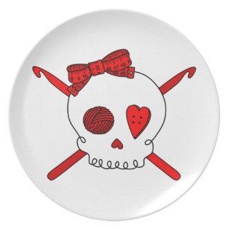 Ganchos del cráneo y de ganchillo (rojos) platos