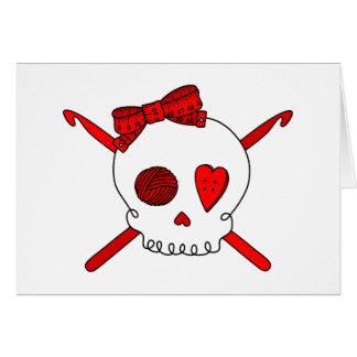 Ganchos del cráneo y de ganchillo rojos felicitacion