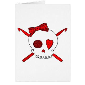Ganchos del cráneo y de ganchillo rojos felicitación