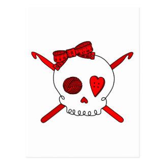 Ganchos del cráneo y de ganchillo rojos