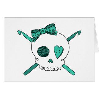 Ganchos del cráneo y de ganchillo turquesa felicitacion