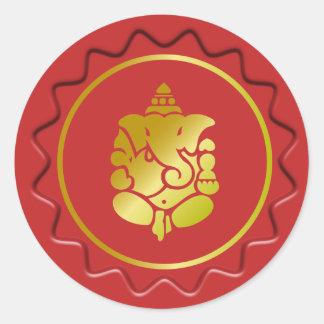 Ganesha de oro en el sello rojo de la cera etiquetas