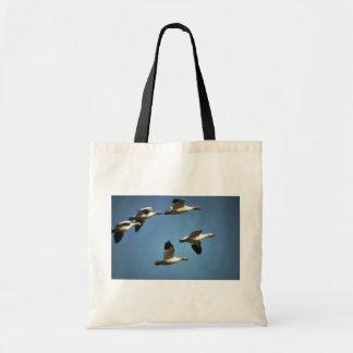 Gansos de nieve en vuelo bolsa tela barata
