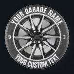 """Garage Or Car Repair Owner Car Wheel On Steel Large Clock<br><div class=""""desc"""">Garage Or Car Repair Owner Car Wheel On Steel with a car wheel and tire in black,  chrome,  steel and silver,  with curved custom text,  great for your business promotion or as a present for your customer</div>"""