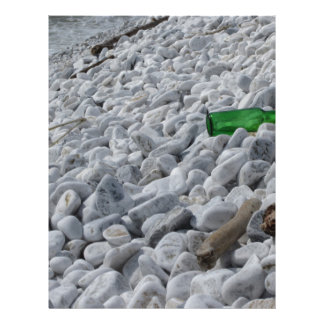 Garbage on the beach .Particular of a green bottle Letterhead