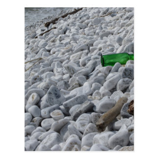 Garbage on the beach .Particular of a green bottle Postcard